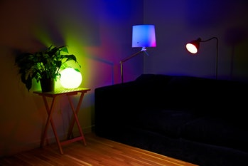 A living room setup with lamps using Philips Hue iPhone-controlled lightbulbs photographed during a ...