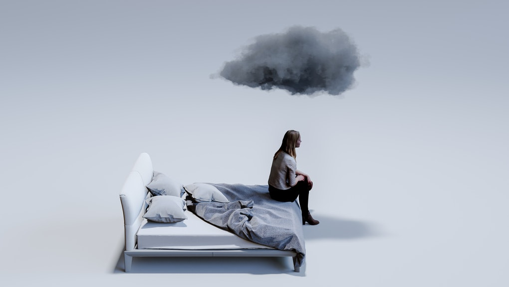 Computer graphic of sad mid adult woman sitting on corner of double bed with dark cloud above head. ...