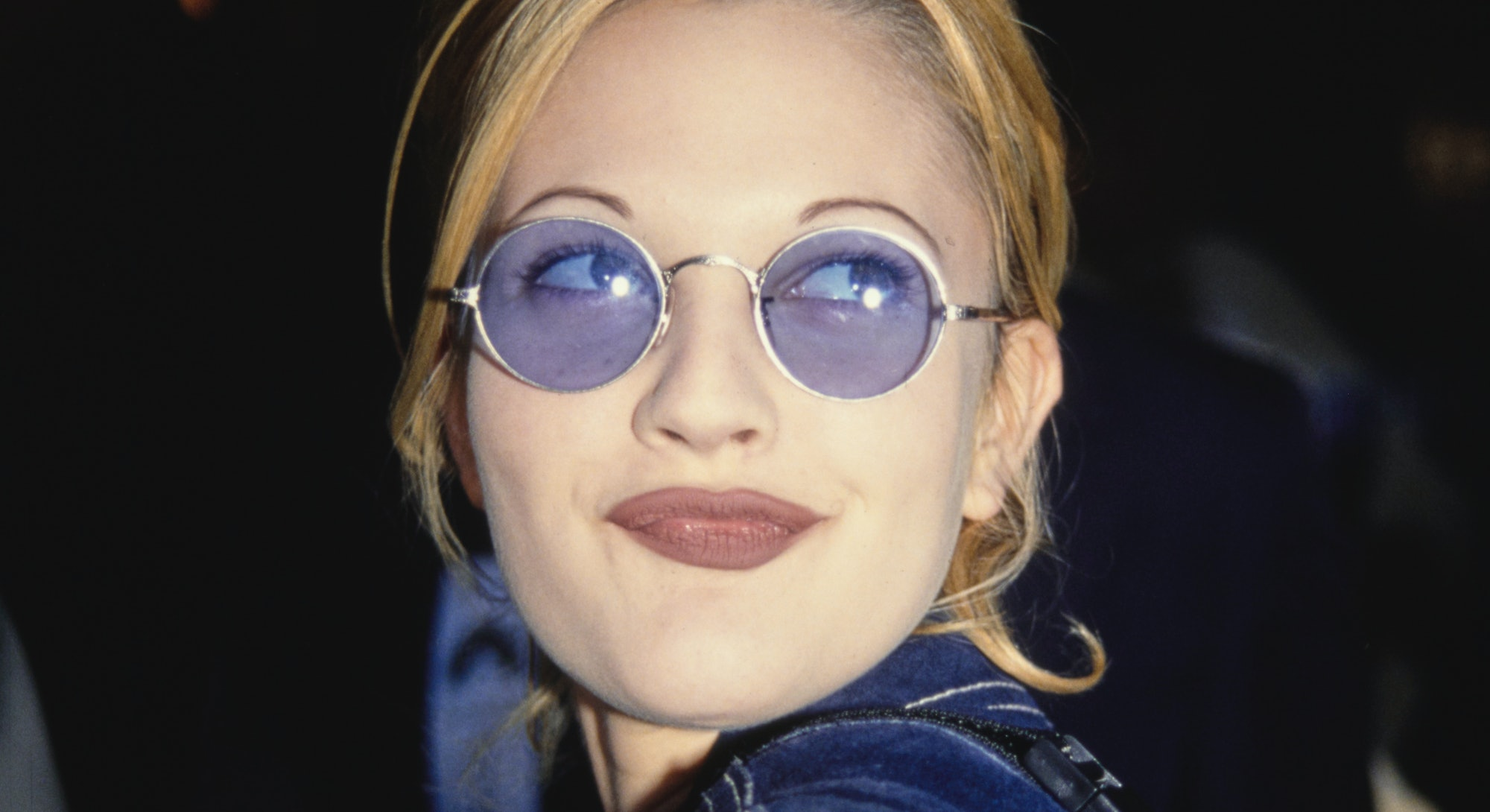 American actress Drew Barrymore, wearing a blue denim jacket and sunglasses, attends the Westwood pr...
