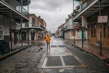 NEW ORLEANS, LOUISIANA - AUGUST 29: A person walks through the French Quarter ahead of Hurricane Ida...