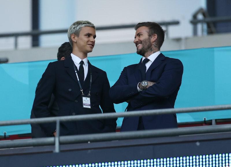 LONDON, ENGLAND - JUNE 18: Romeo Beckham and David Beckham, Former England International react as th...