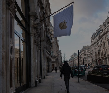 LONDON, UNITED KINGDOM - 2021/02/10: A man walking past the Apple stores  in London, during the thir...