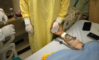 LOS ANGELES, CA - FEBRUARY 01: Registered Nurse Jess Esperti, left, holds Mariano Zuniga Anaya's han...