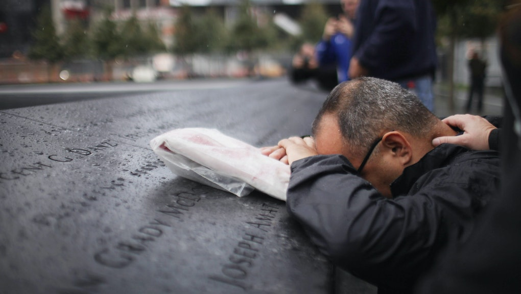 NEW YORK, NY - SEPTEMBER 20:  Eddie Reyes is comforted while remembering fifteen of his colleagues i...