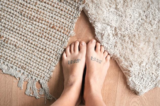 Minimalist tattoo meaning: GPS coordinates of hometown