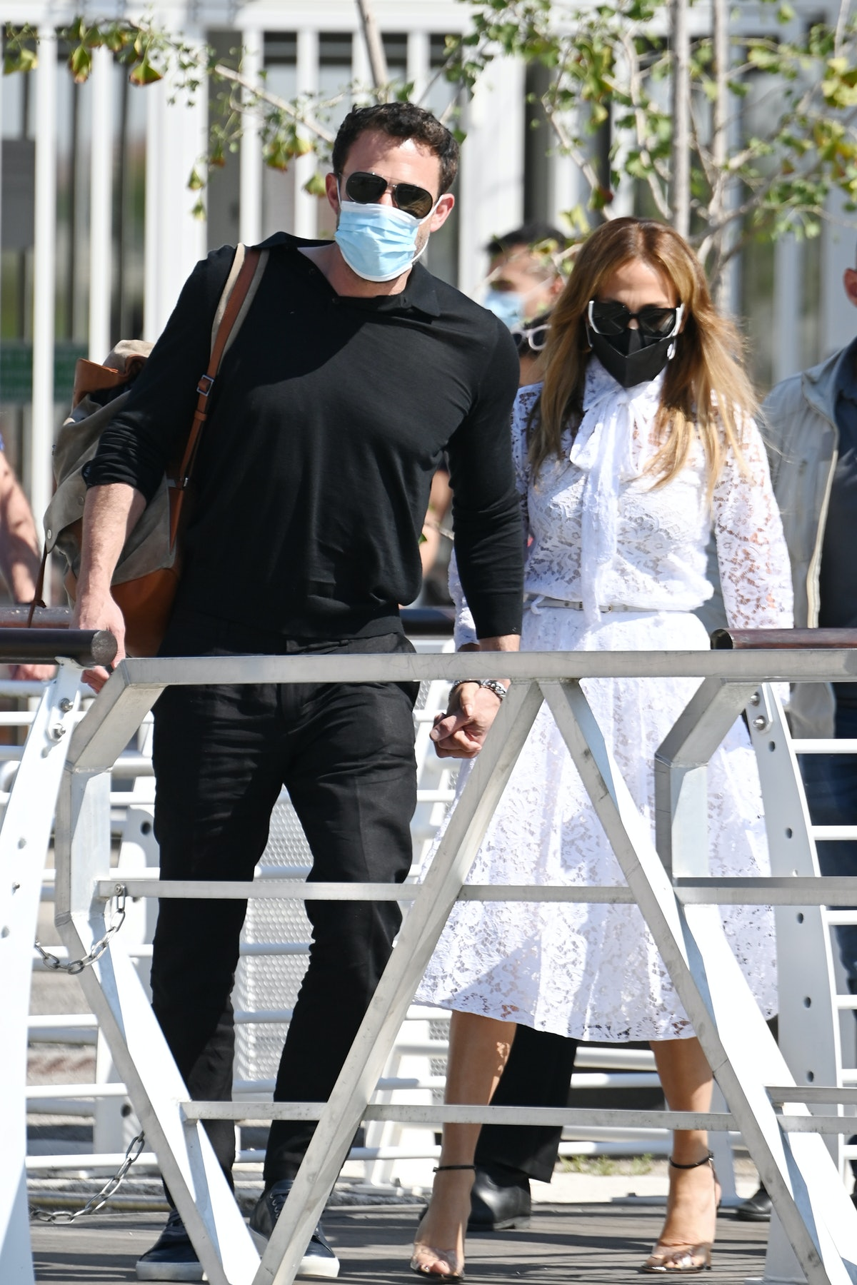 Jennifer Lopez wears white lacey Valentino shirt dress Gia strappy black heels from FEMME, and a Her...