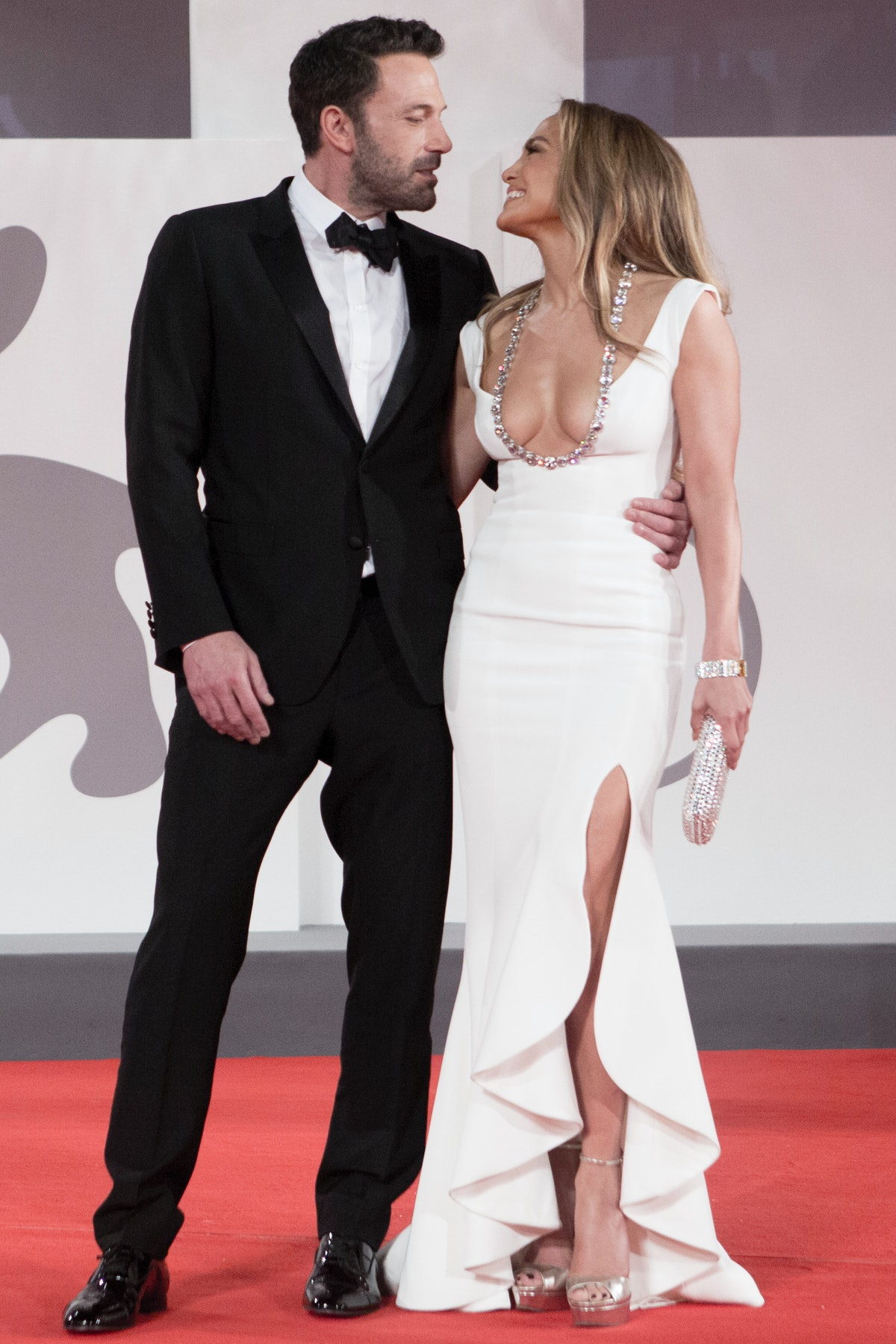 """VENICE, ITALY - SEPTEMBER 10:  Jennifer Lopez and Ben affleck attend the red carpet of the movie """"Th..."""