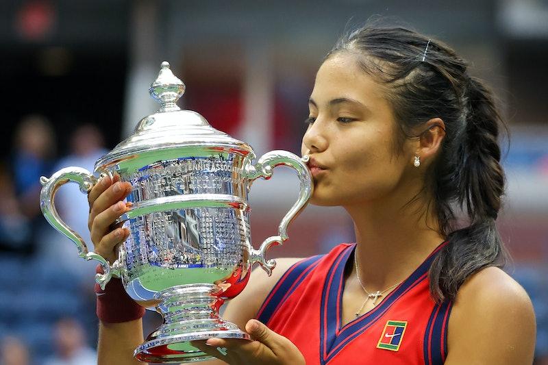 NEW YORK, NEW YORK - SEPTEMBER 11: Emma Raducanu of Great Britain celebrates with the championship t...