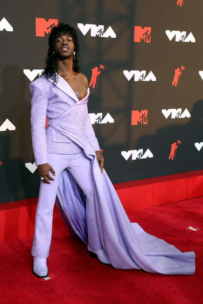 The VMAs 2021 red carpet fashion was truly wild, from Lil Nas X's cape to Doja Cat's lace. Here are ...