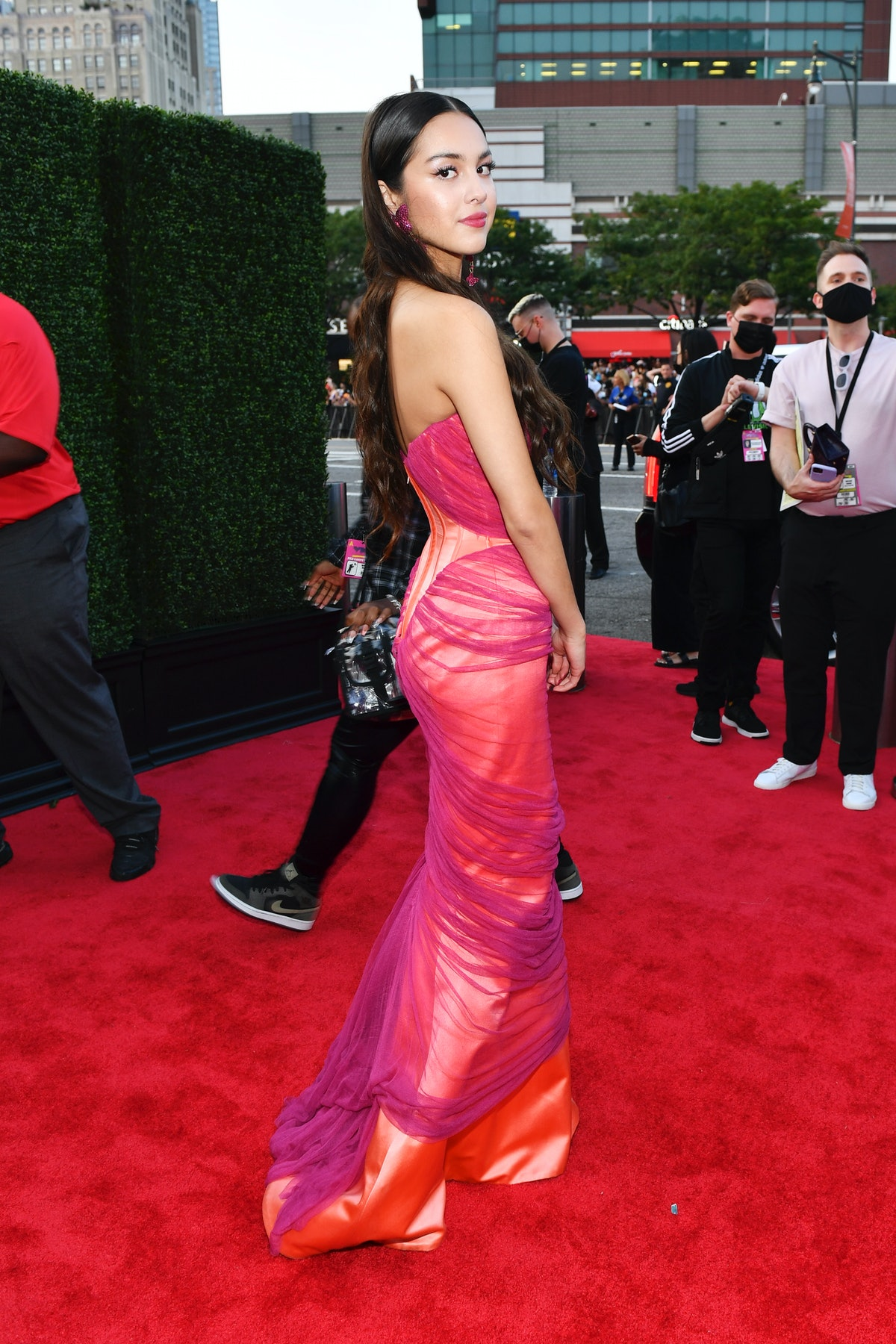 Olivia Rodrigo at the 2021 VMAs in a pink-and-purple gown.