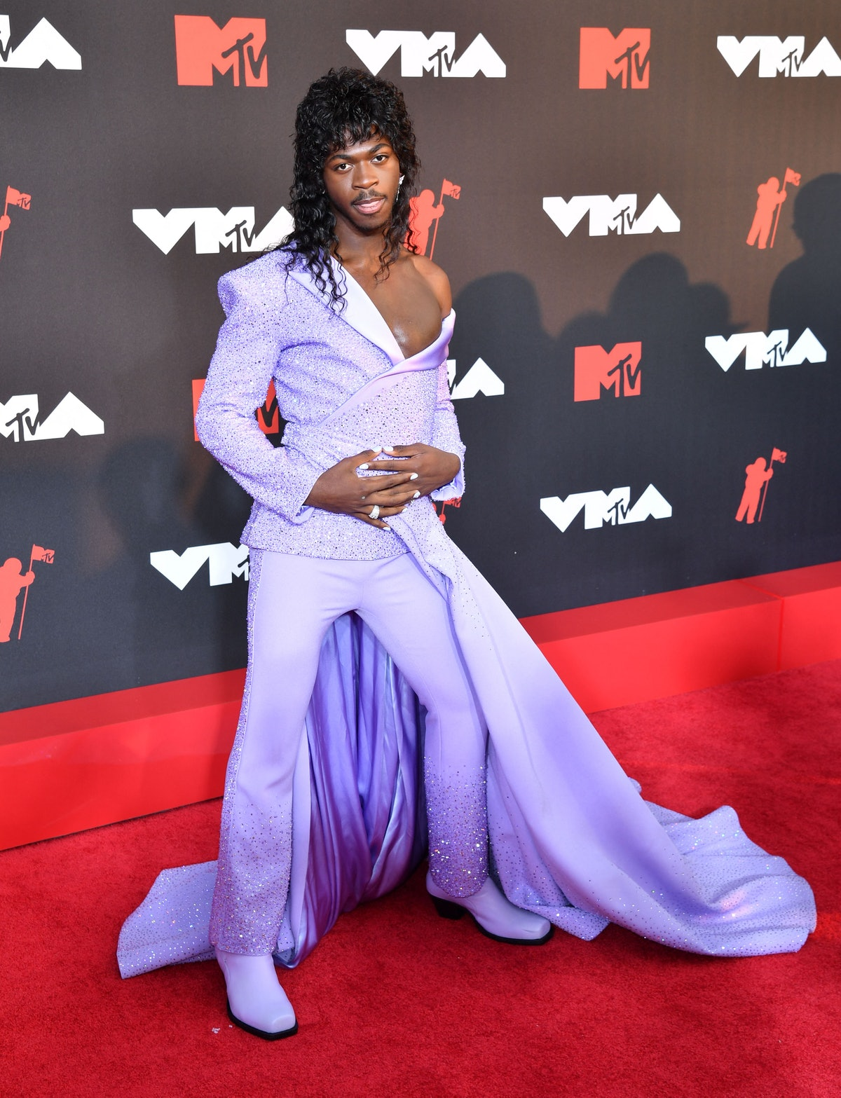 Lil Nas X in a lavender suit and dress combo at the 2021 VMAs.