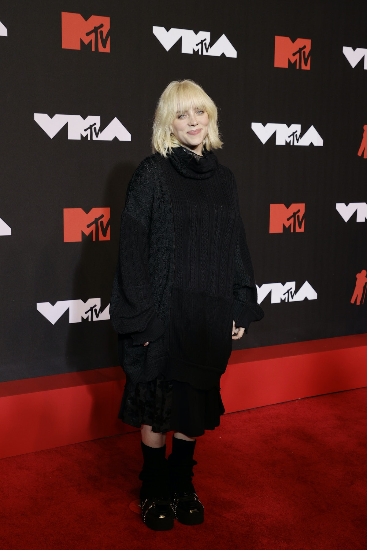 Billie Eilish's 2021 MTV VMAs look is an oversized sweater dress witha  chunky knit and turtleneck