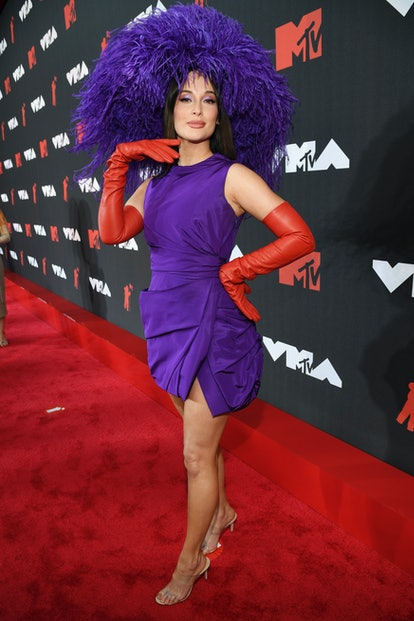 Kacey Musgraves' VMAs 2021 red carpet look included a bold, poufy hat that channeled Red Hat Society...