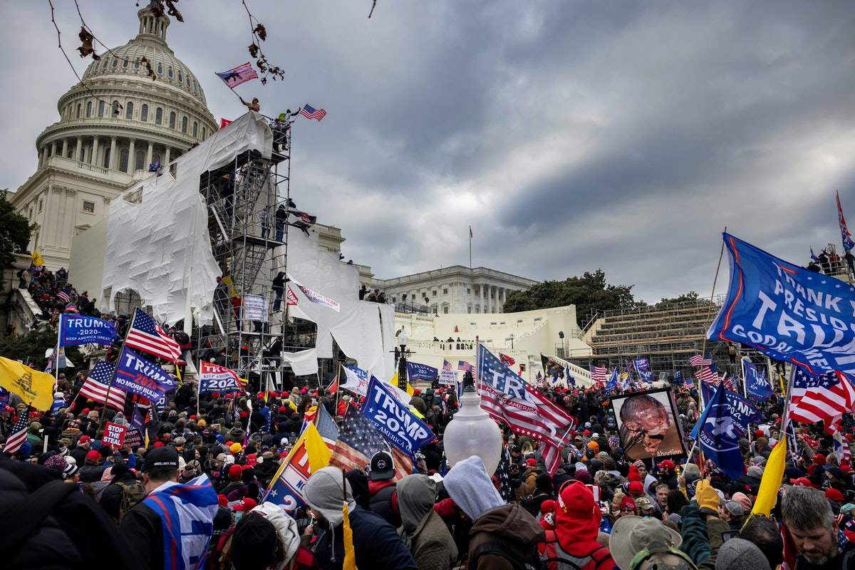 Trump supporters clash with police and security forces as people try to storm the US Capitol on Janu...