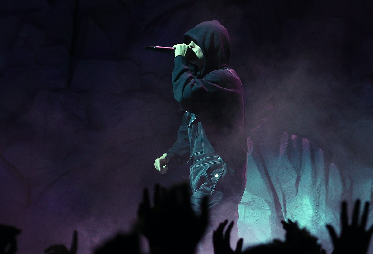 Justin Bieber performs at the 2021 MTV VMAs wearing a black hoodie.