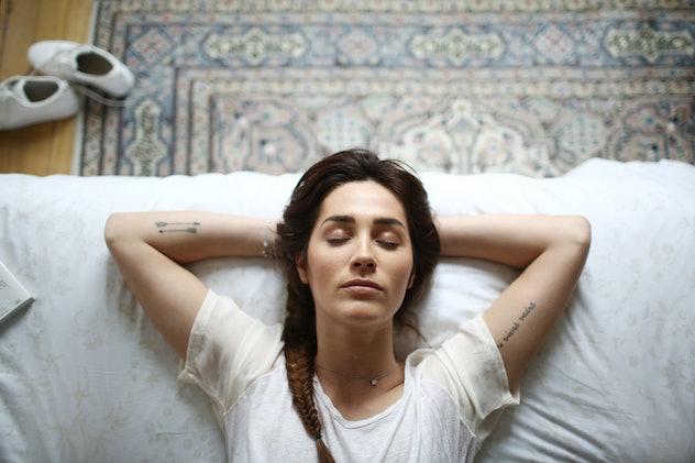 woman with arrow tattoos