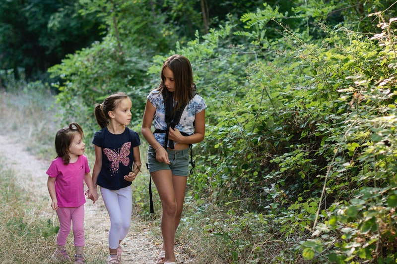 Three girls hiking in the nature