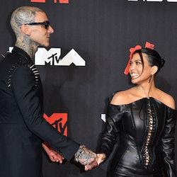 Travis Barker and Kourtney Kardashian at the 2021 MTV Video Music Awards on Sept. 12, 2021.