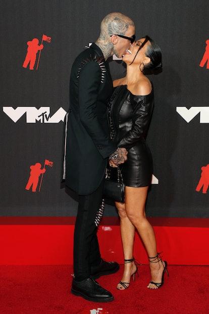 Travis Barker and Kourtney Kardashian arrive for the 2021 MTV Video Music Awards.