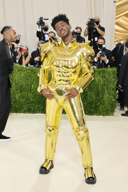 Lil Nas X's Met Gala 2021 look included 2 outfits which he removed to reveal a third: a gold catsuit...