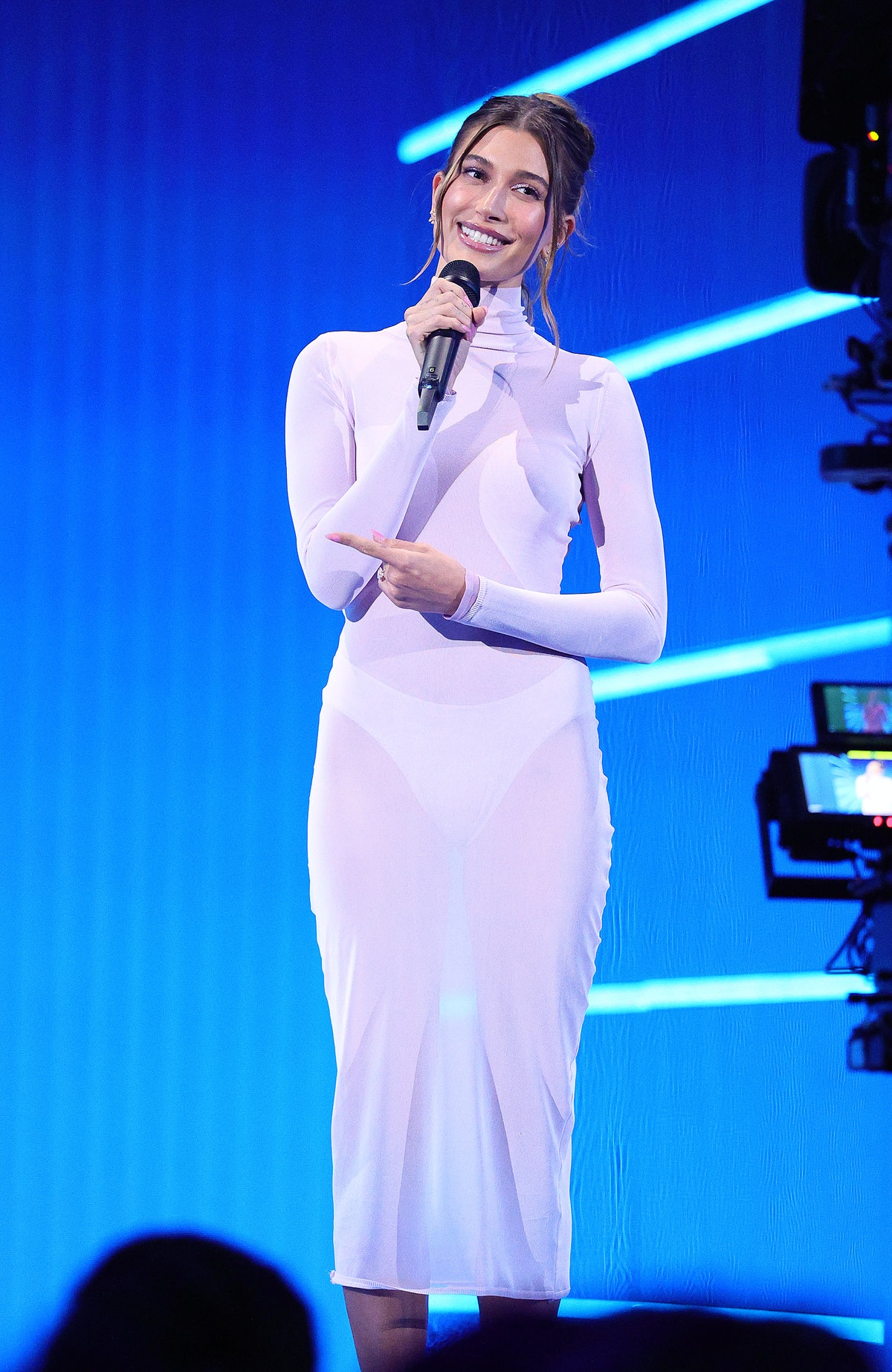 Hailey Bieber wear a sheer, white body con dress to the 2021 MTV Video Music Awards at Barclays Cent...