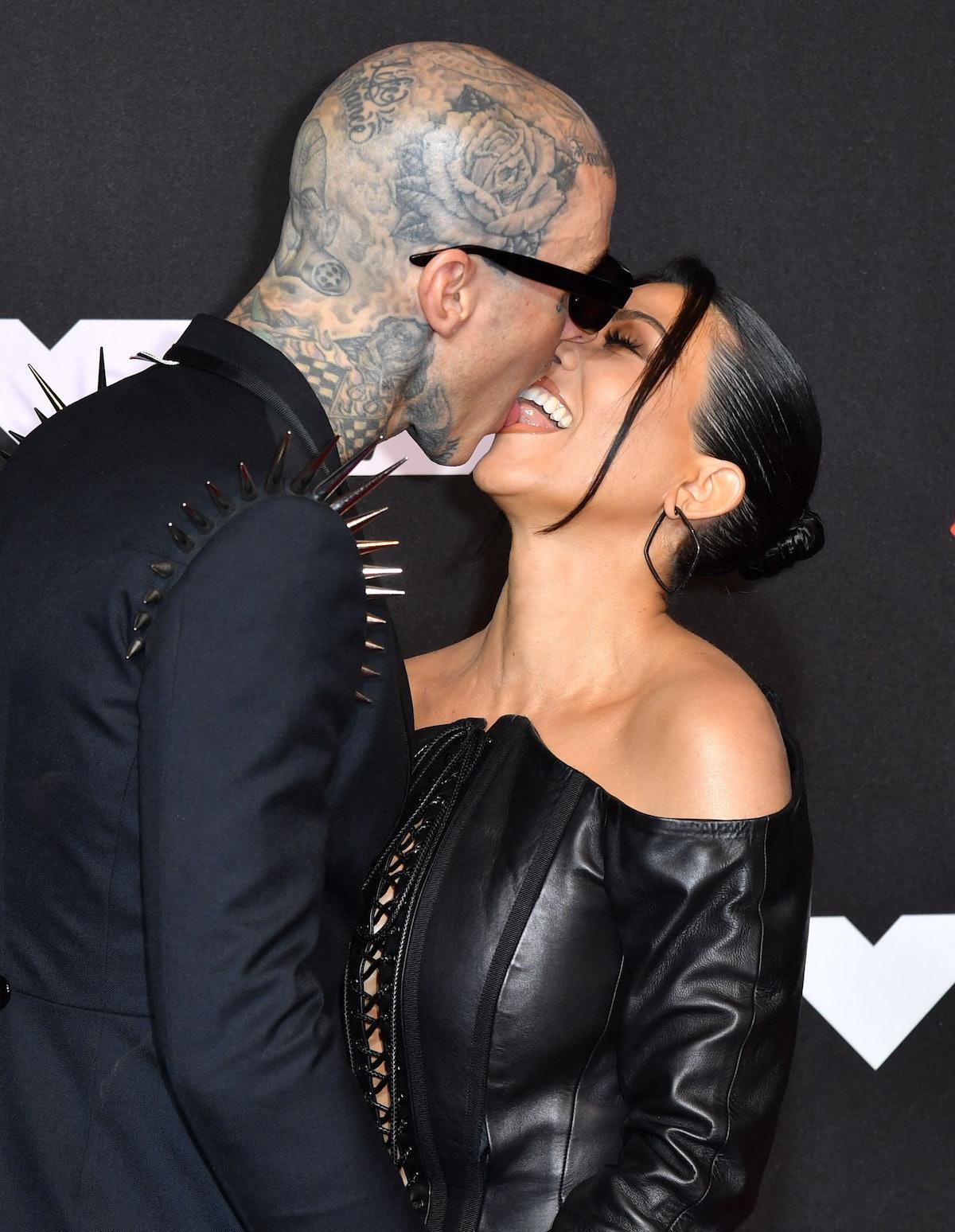 Travis Barker and Kourtney Kardashian kissing on the red carpet at the 2021 VMAs.