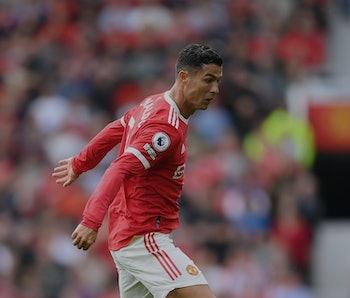 MANCHESTER, ENGLAND - SEPTEMBER 11: Cristiano Ronaldo runs with the ball during the Premier League m...