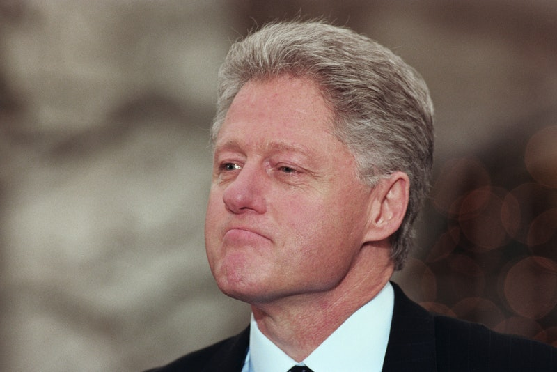 President Bill Clinton reacts to being impeached by the House of Representatives during a news confe...