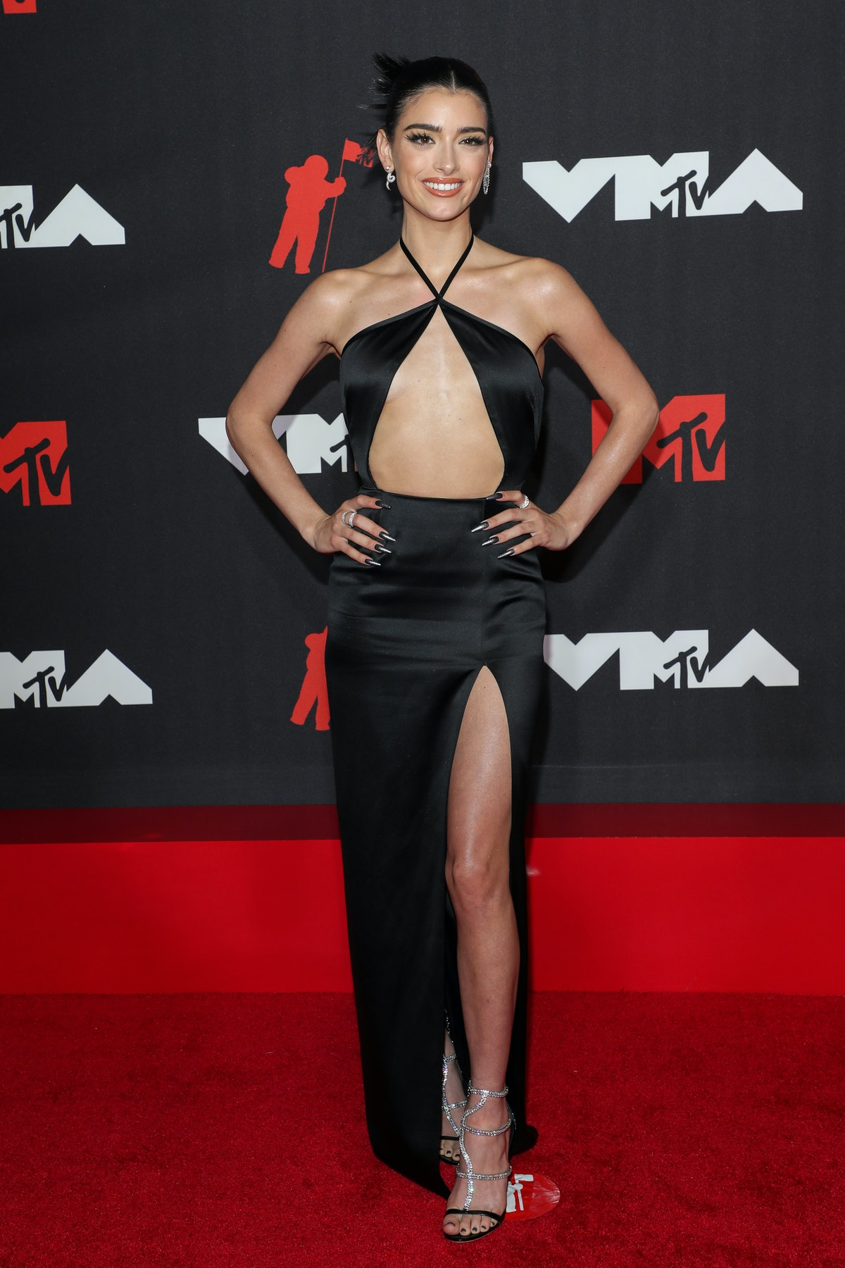 Dixie D'Amelio wore a black satin cutout dress to the VMAs