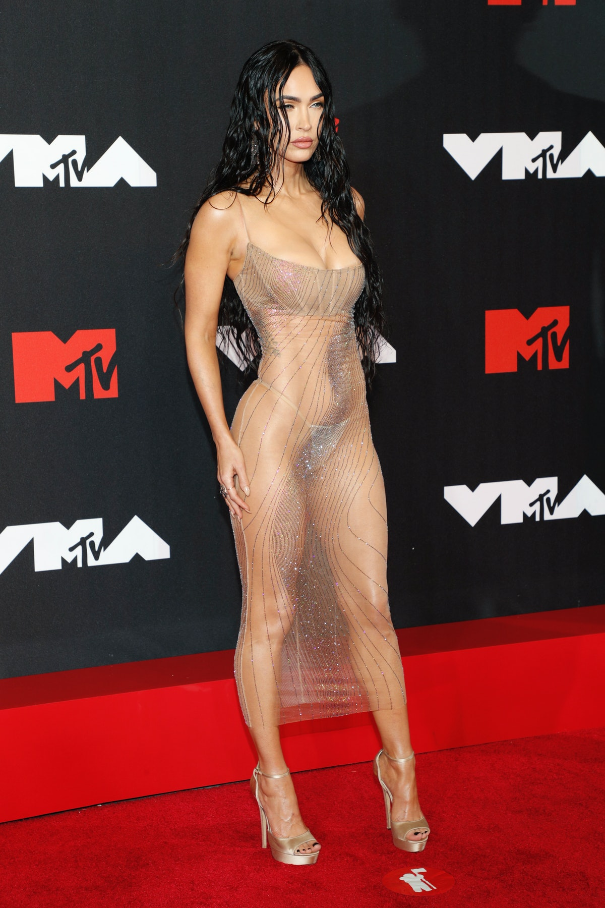 Megan Fox's 2021 VMAs dress was a nude illusion dress that was completely sheer, showing her sparkly...