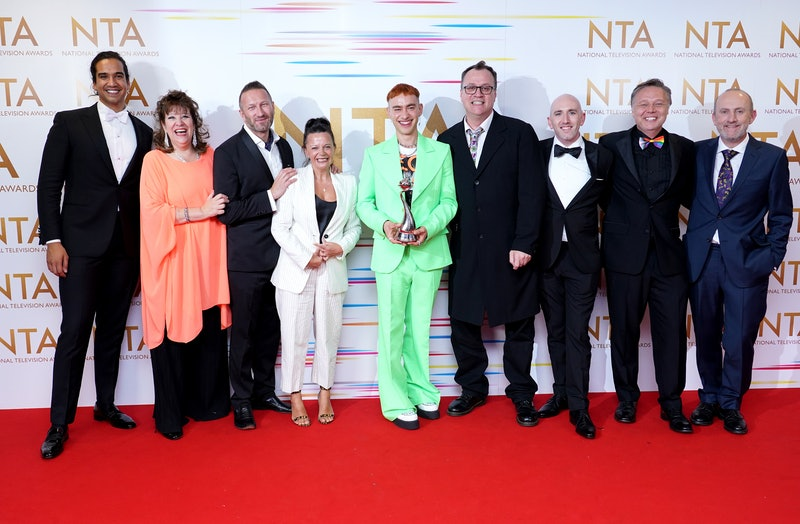 Olly Alexander (centre), Russell T Davies and the cast and crew of It's A Sin in the press room afte...