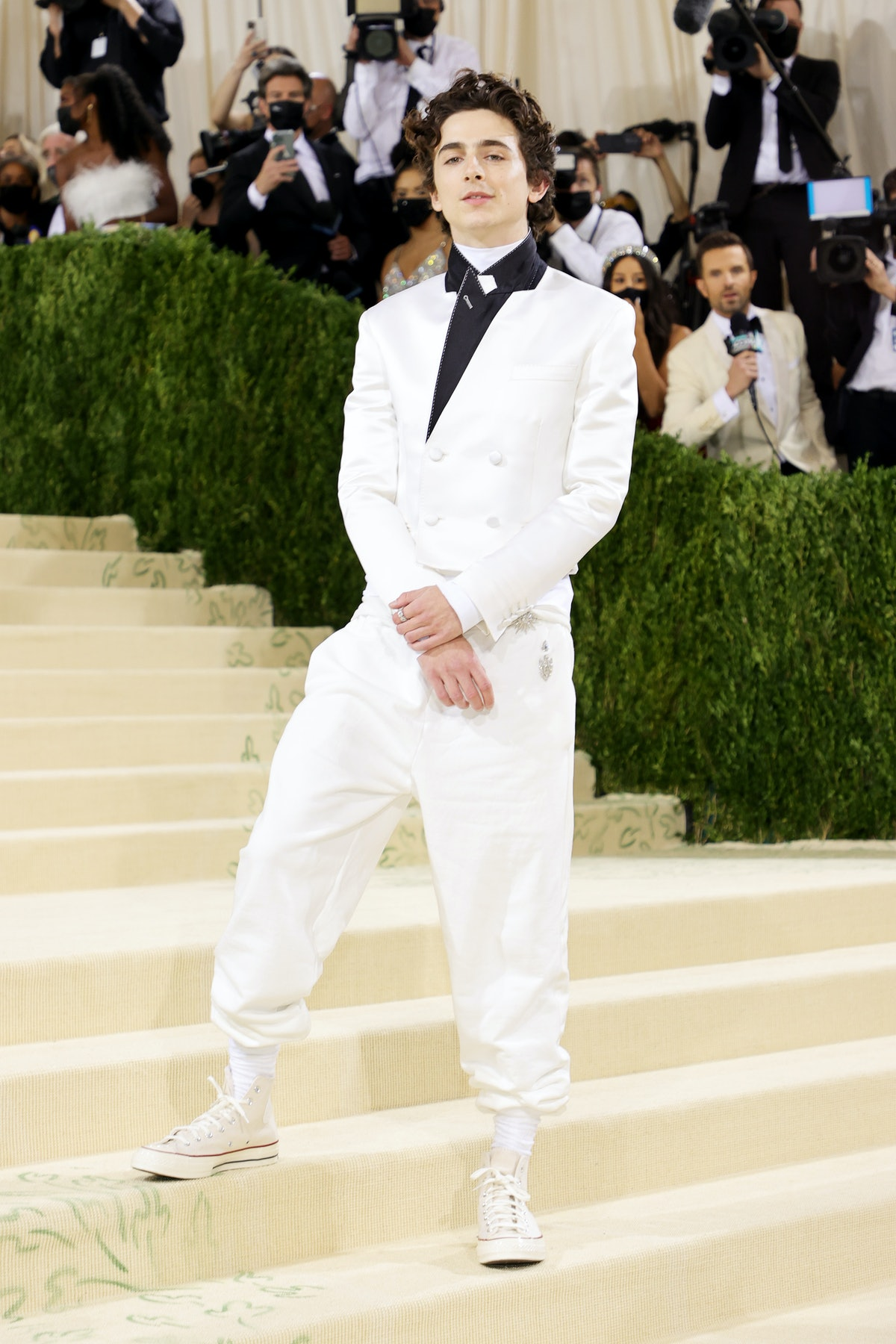 Co-chair Timothée Chalamet attends The 2021 Met Gala  in a white satin Haider Ackermann.
