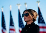 Outgoing First Lady Melania Trump listens as her husband Outgoing US President Donald Trump addresse...