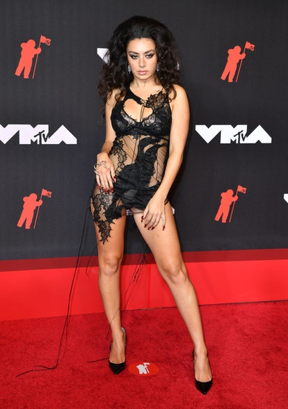 English singer-songwriter Charli XCX arrives for the 2021 MTV Video Music Awards at Barclays Center ...