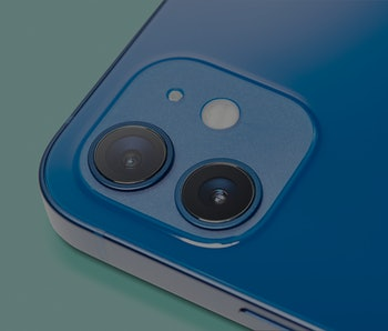 Detail of the camera lenses on an Apple iPhone 12 with a Blue finish, taken on October 28, 2020.(Pho...