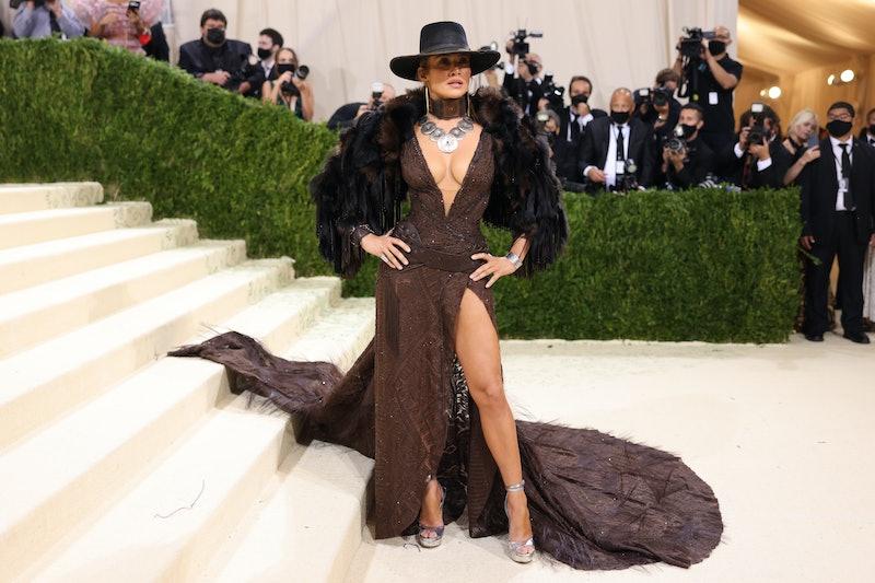 Jennifer Lopez's Met Gala 2021 look, designed by Ralph Lauren, channeled a glamorous cowgirl.