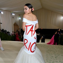 """The Met Gala 2021 red carpet was full of political statements, from AOC's """"Tax The Rich"""" dress to Me..."""