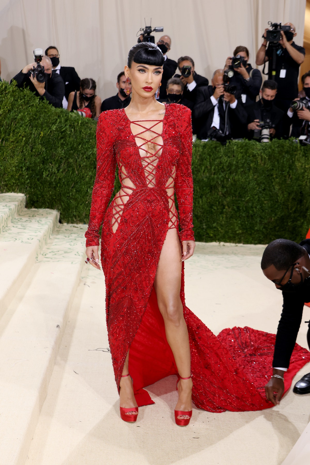 Megan Fox's 2021 Met Gala gown was red and featured lace embroidery.