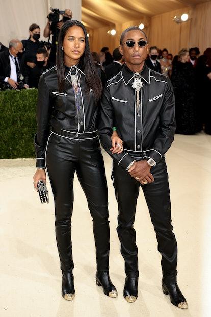 NEW YORK, NEW YORK - SEPTEMBER 13: Helen Lasichanh and Pharrell Williams attend The 2021 Met Gala Ce...