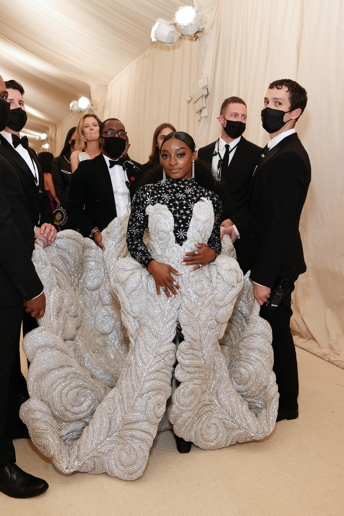 Simone Biles attends The 2021 Met Gala with an entourage to carry her gown