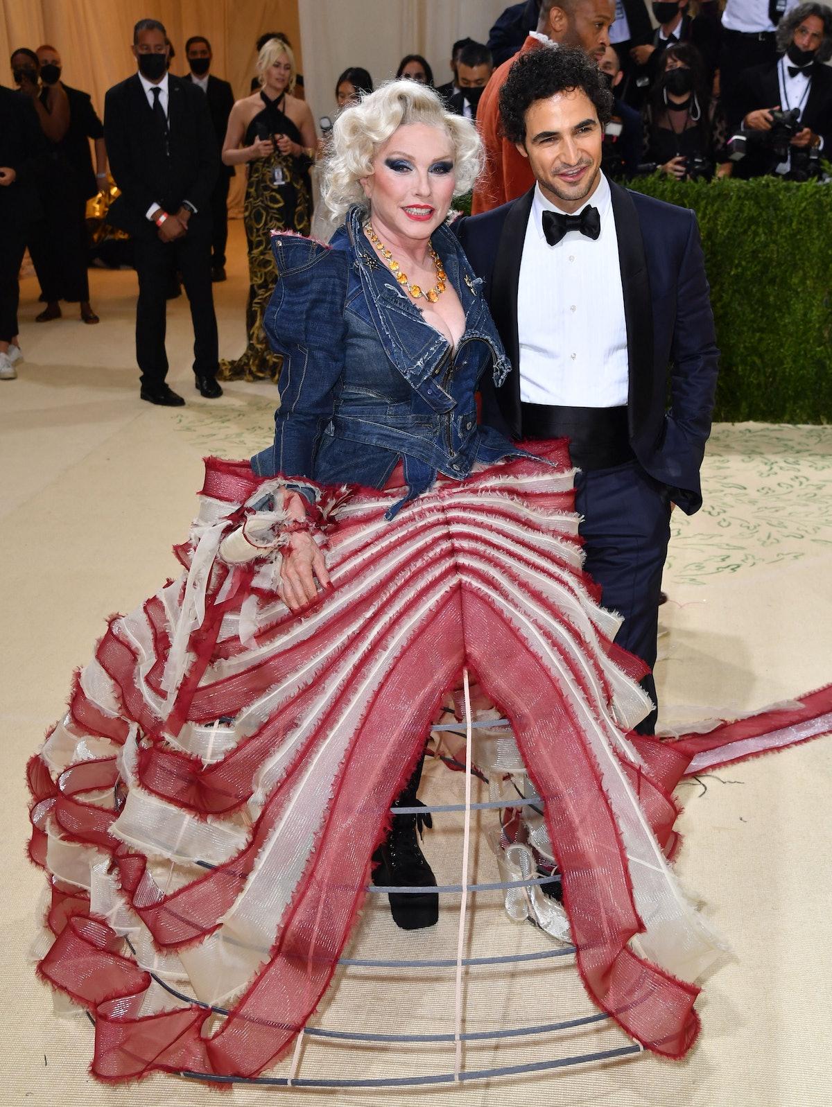 US singer Debbie Harry (L) and designer Zac Posen arrive for the 2021 Met Gala at the Metropolitan M...