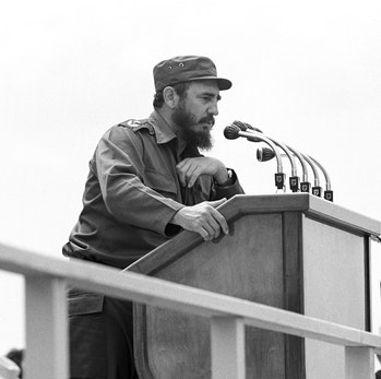 Cuban president Fidel Castro gives a speech at a public meeting in Cienfuegos in front of head of th...