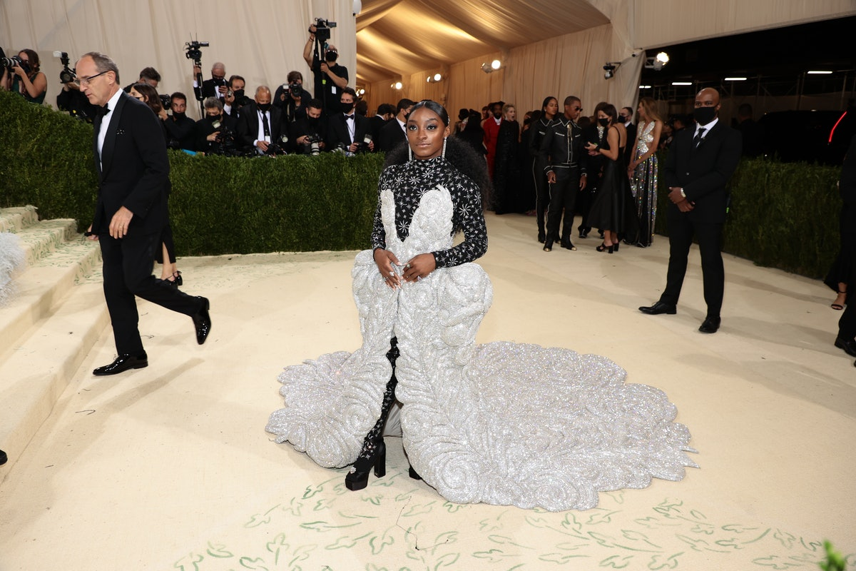 Simone Biles attends The 2021 Met Gala in an 88-pound dress.