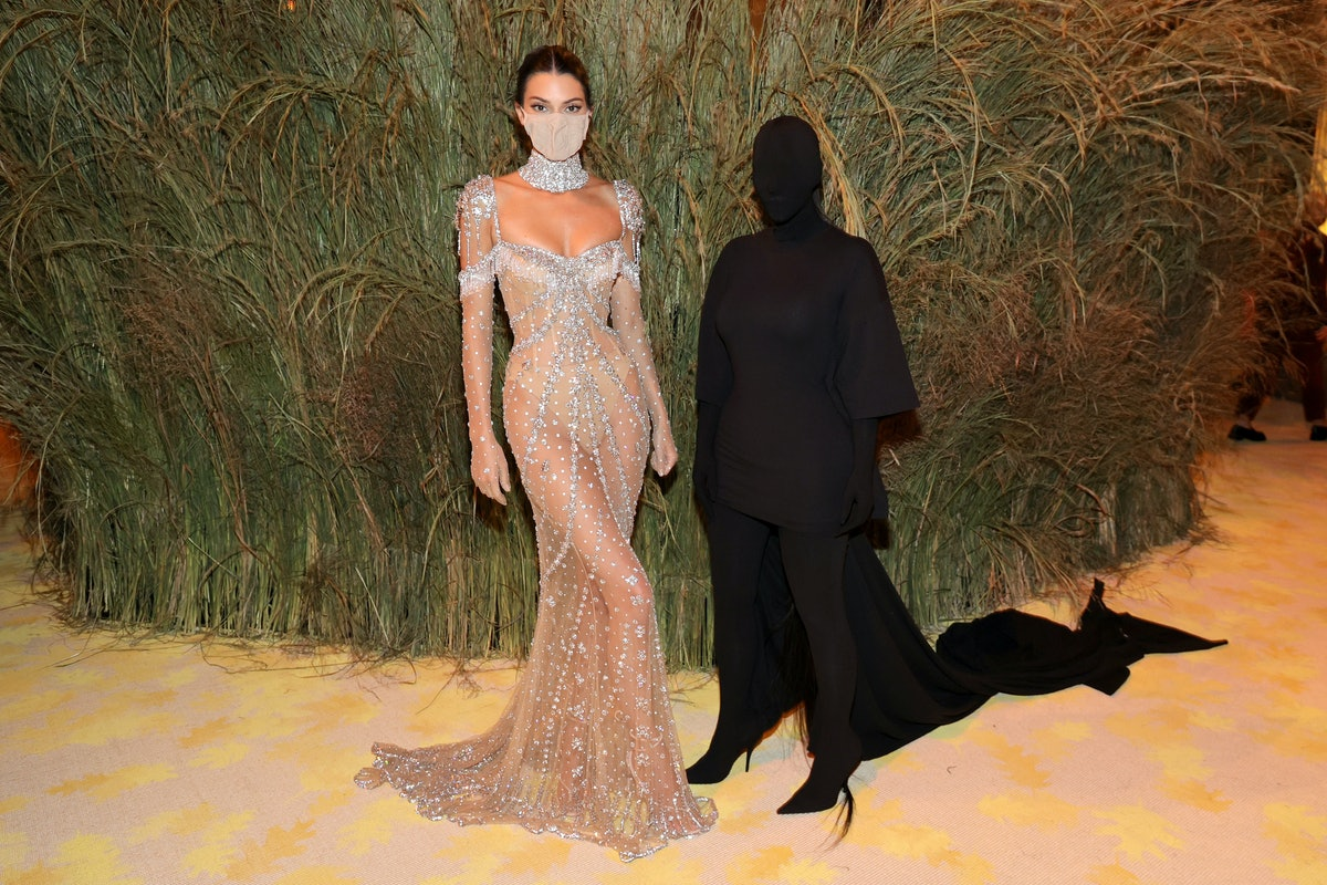 Kendall Jenner and Kim Kardashian attend the The 2021 Met Gala.