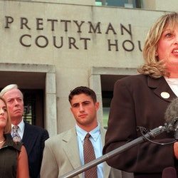 Linda Tripp (R) speaks to the press in front of the Federal Courthouse 29 July in Washington, DC, af...