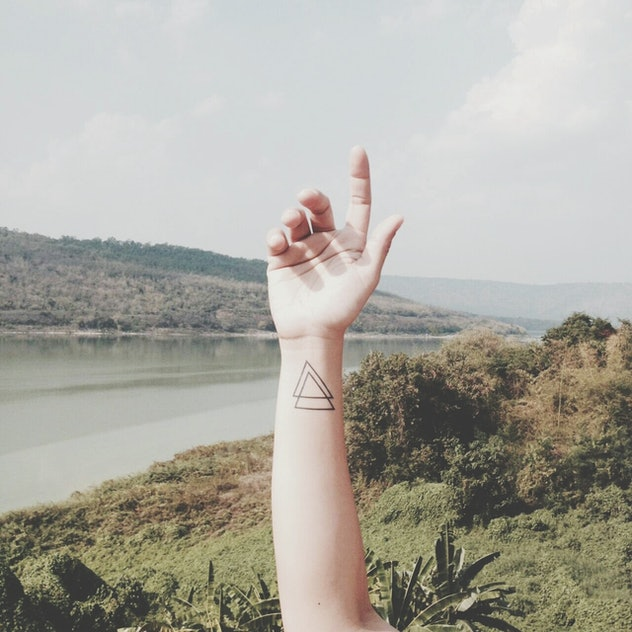 Matching minimalist tattoos for families: triangles
