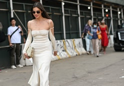 NEW YORK, NEW YORK - SEPTEMBER 12:  Kat Collings is seen wearing a white Jacquemus dress outside the...