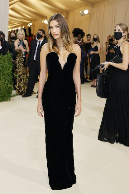 Hailey Bieber's Met Gala 2021 look included a velvet bodice and a dramatic plunging neckline.