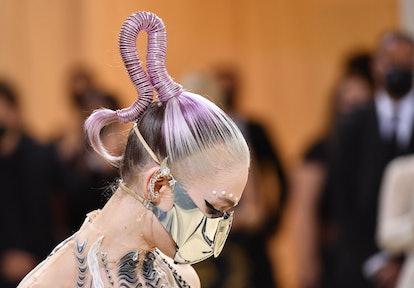 TOPSHOT - Canadian musician Grimes arrives for the 2021 Met Gala at the Metropolitan Museum of Art o...
