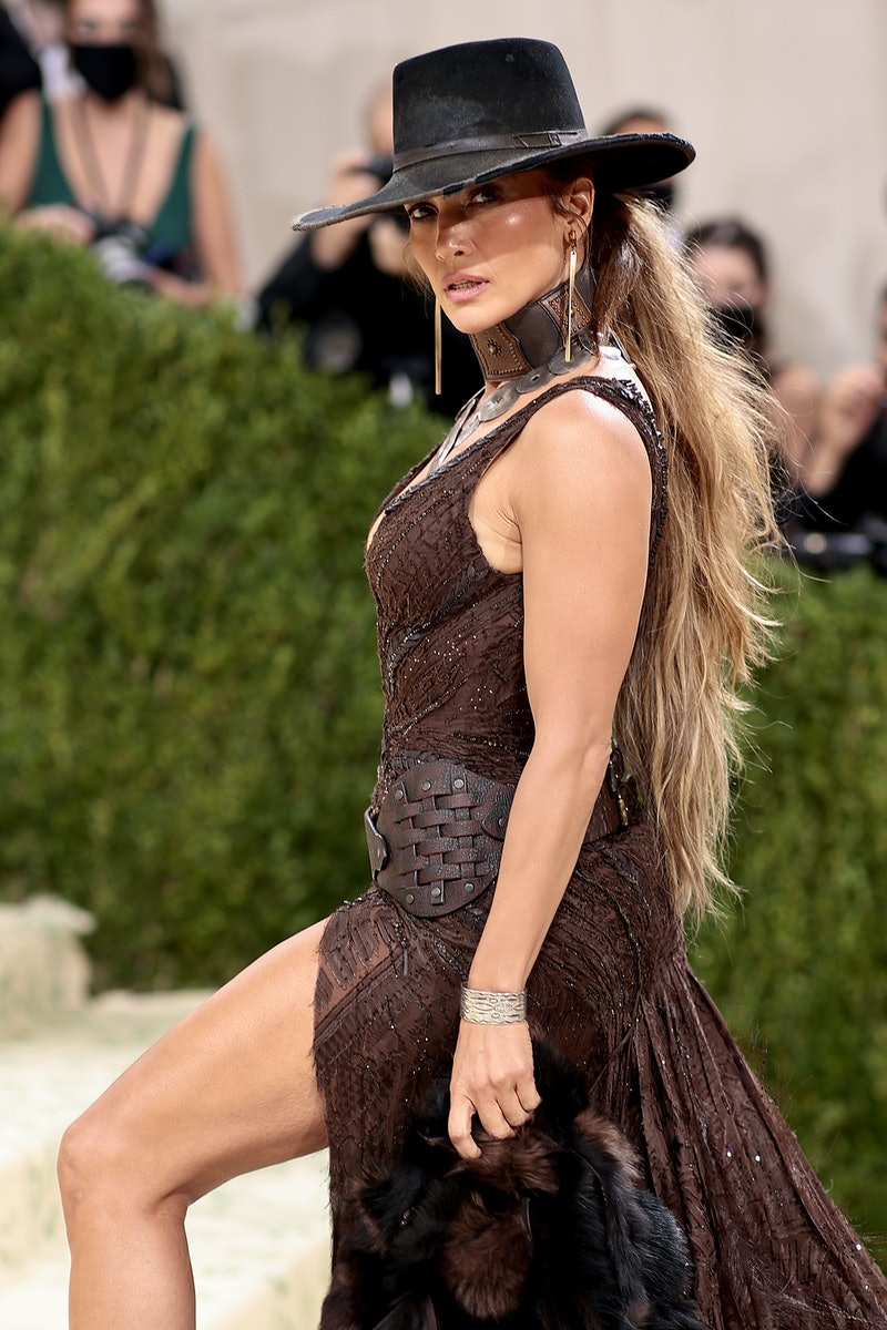 Jennifer Lopez attends The 2021 Met Gala with an epic ponytail styled by Lorenzo Martin.